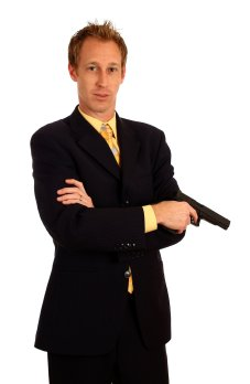 13272-a-young-businessman-in-a-suit-holding-a-pistol-pv