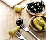 Pickles,Green And Black Olives On A Wooden Board